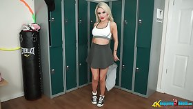 Playful blondie in short skirt Ashley Jay shows striptease in the locker room